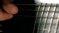 Man's hand touching strings. FullHD macro video video