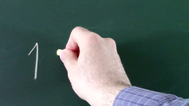Man's hand writing with chalk on blackboard a false equation in which one plus one equals three , conceptual footage about surprising results arising from common and well established assumptions video