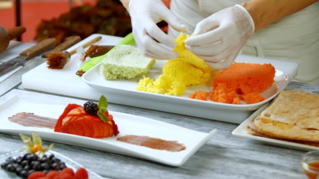 Man's hands break colorful bread. video