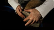 man's hands drumming out a beat on an arabic percussion drum named Tombak video