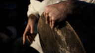man's hands drumming out a beat on an arabic percussion drum named Bendir video