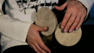 man's hands drumming out a beat on an arabic percussion drum named Kasoureh video