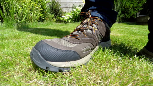 Mans outdoor shoe/boot in a garden video