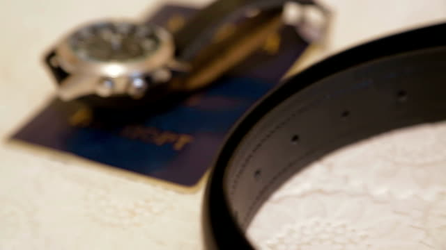 Man's Passport, Watch And Belt On Table video