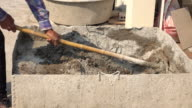 Manual cement mixer with construction worker video