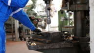 Manual worker on working drill in factory plant video