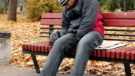 Manual worker sleeping drunk on bench, problems with health, unhealthy lifestyle video