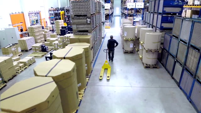 Manual worker using pallet truck video