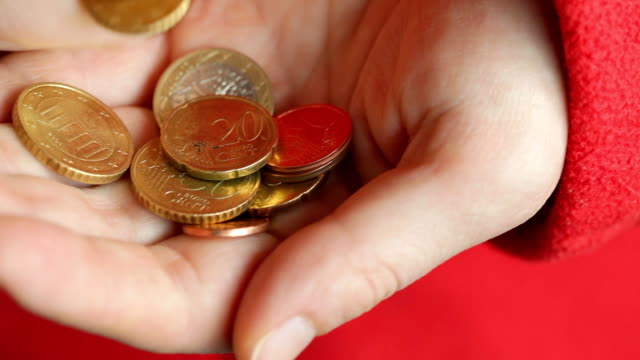 Manually counting euro coins video