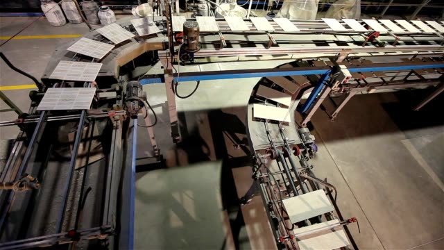 Manufacture of ceramic tiles, Automated line for the production of ceramic tiles, Industrial interior, conveyor video
