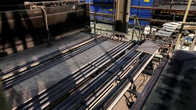 Manufacture of ceramic tiles, Automated line for the production of ceramic tiles, Industrial interior, conveyor, time laps video