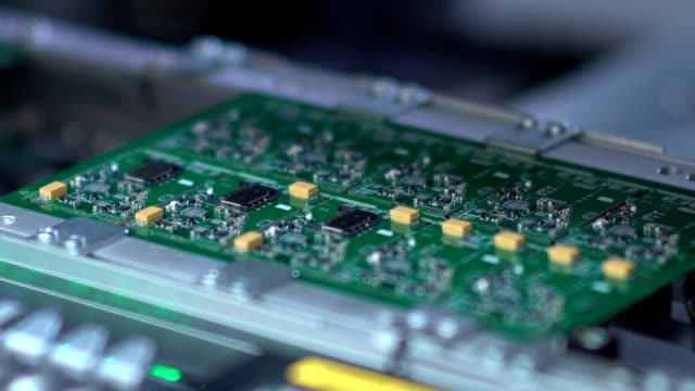 Manufacture of electronic chips. Producing Printed Circut Board video