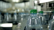 Manufacturing and filling plastic bottles with drinking water video