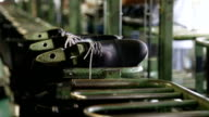 Manufacturing shoes in a shoe factory (close-up) video