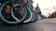 Many bicycles parked in point rental of ecological transport video