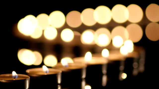 Many Candles light on black background video