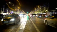 Many cars driving night city road, trees decorated with bright sparkling lights video