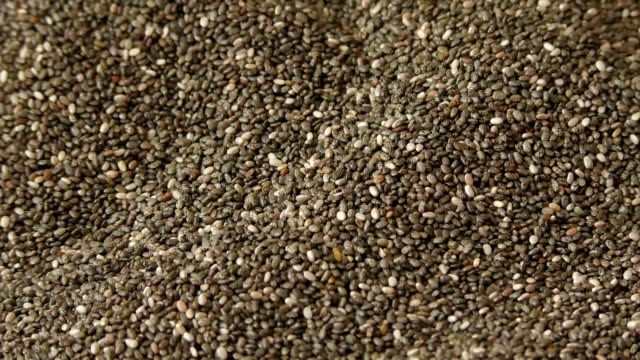 Many chia seeds falling on the table video