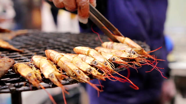Many kinds of seafood at the street food-fest. Saleswoman. Mediterranean video
