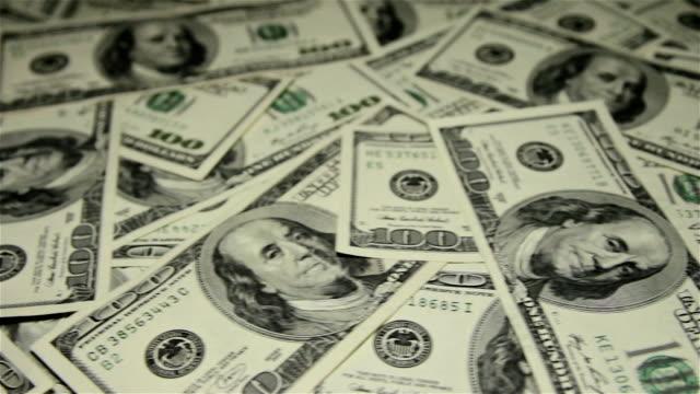 Many money on the table. Slider shot. video