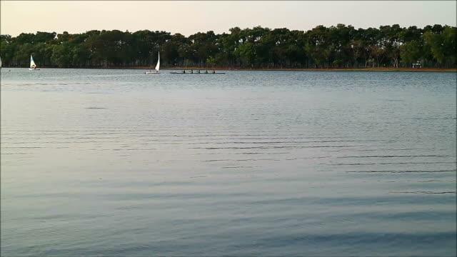 Many People Enjoying Sailboats and Kayak on the Lake of Public Park, a Sunday Evening in Bangkok video
