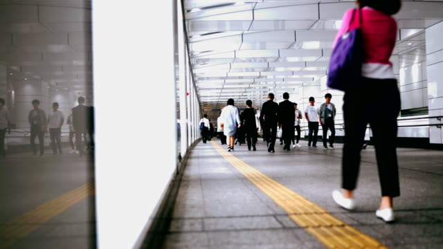Many people passing through a walkway in Tokyo video