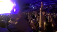 Many people waving hands, supporting singer performing at popular TV talent show video