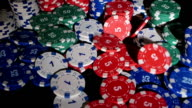 many poker chips falling on a black background. two pack. video
