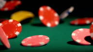 Many poker chips falling on green casino table, gambler winning video