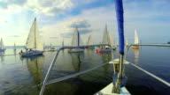 POV many sailing yachts in the sea, regatta, beautiful seascape video