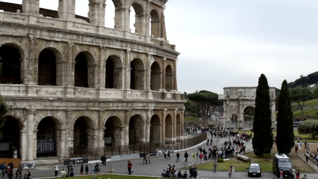 Many tourists walking near Coliseum amphitheater in Rome, Italy. Sightseeing video