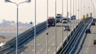 Many trucks and cars go over the bridge. Saint-Petersburg, Russia, 2016 video