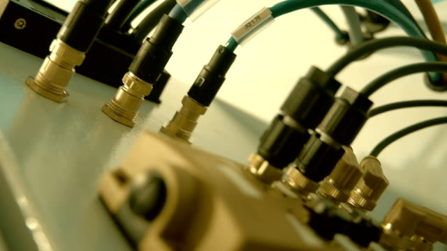 Many wires and connectors in electronic equipment for the control of the process video