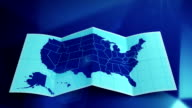 USA map folds out on blue. Three in one. video