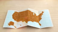 USA map folds out on desk. Three in one. video