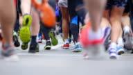 HD - Marathon. Runners legs. Slow-mo video