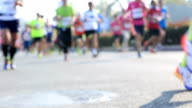 Marathon running race, people feet on city road video