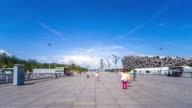 marble square and Beijing Nest Stadium in blue sky. timelapse 4k hyperlapse video