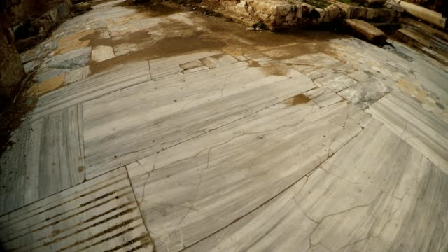 Marble tiles of Antique street close up ruins Salamis Cyprus video