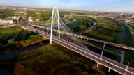 Margaret Hunt Hill Bridge spanning across the Trinity River in Dallas Texas During Sunirse video