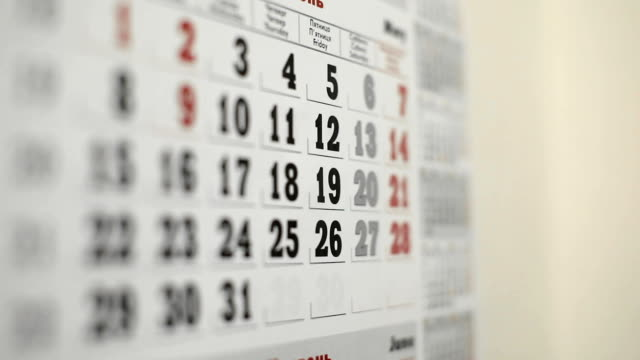 Mark the date in wall calendar with blue marker video