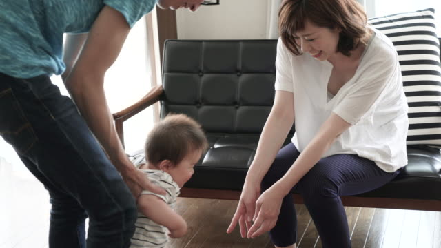 Married couple and Baby Boy having fun time in house. video