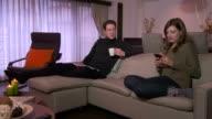 Married Couple Husband And Wife Relaxing On Couch At Home video