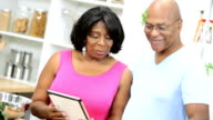 Married Ethnic Couple Using Wireless Tablet Home Kitchen video