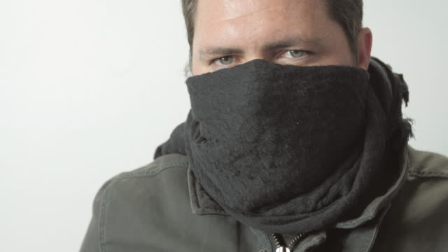 Masked Man Close Up Quickly Draws a Gun video