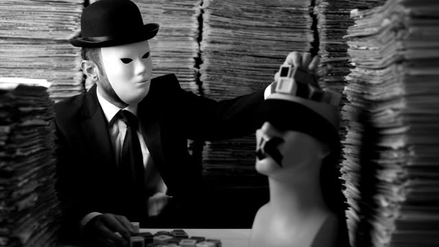 Masked Man Filling Mannequin Head With Letters For Censorship Concept video