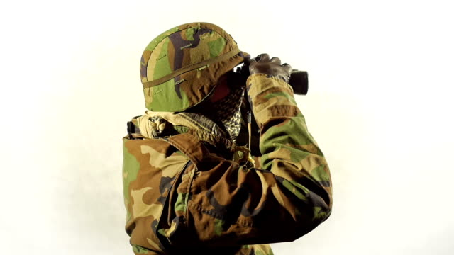 Masked soldier with binoculars. video