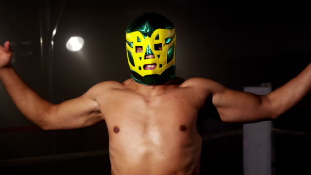 Masked wrestler in boxing ring video