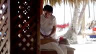 Massage therapist finishing spa treatment video