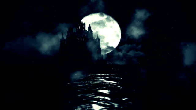 A Massive Black Castle in The Middle of the Sea with a Rising Full Moon at Night video
